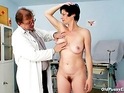 Hot mature gets her hairy pussy stretched with gyno tools