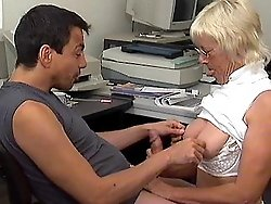 A sexy granny takes a fucking at work